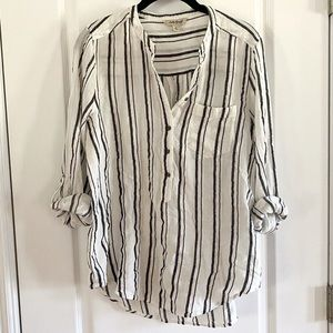 Women's button down striped and flowy top.
